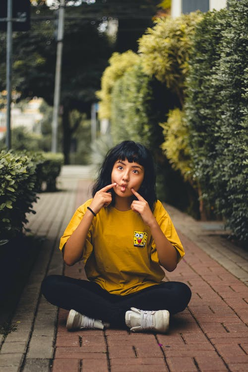 Woman In Yellow Long Sleeved Shirt And Black Pants