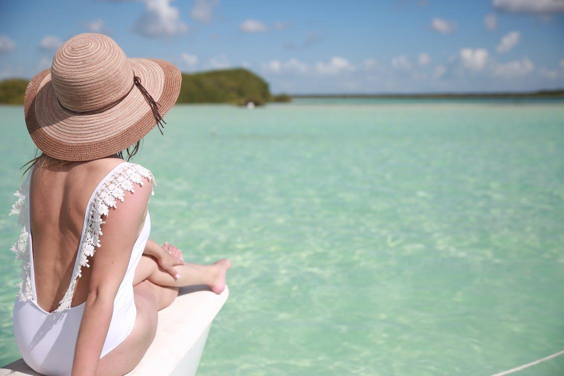 Woman Sunbathing Wearing White Swimsuit