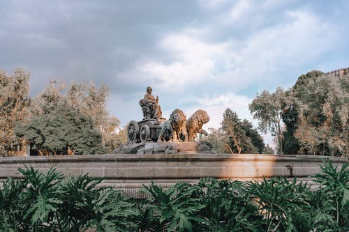 Man and Woman Sitting Statue