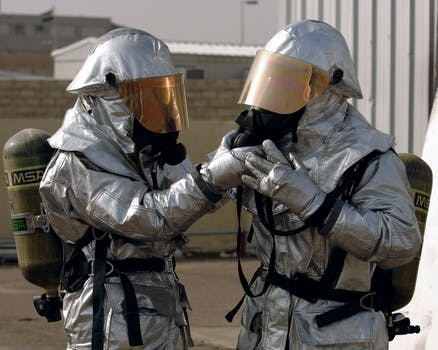 Two Person Wearing Protective Gears