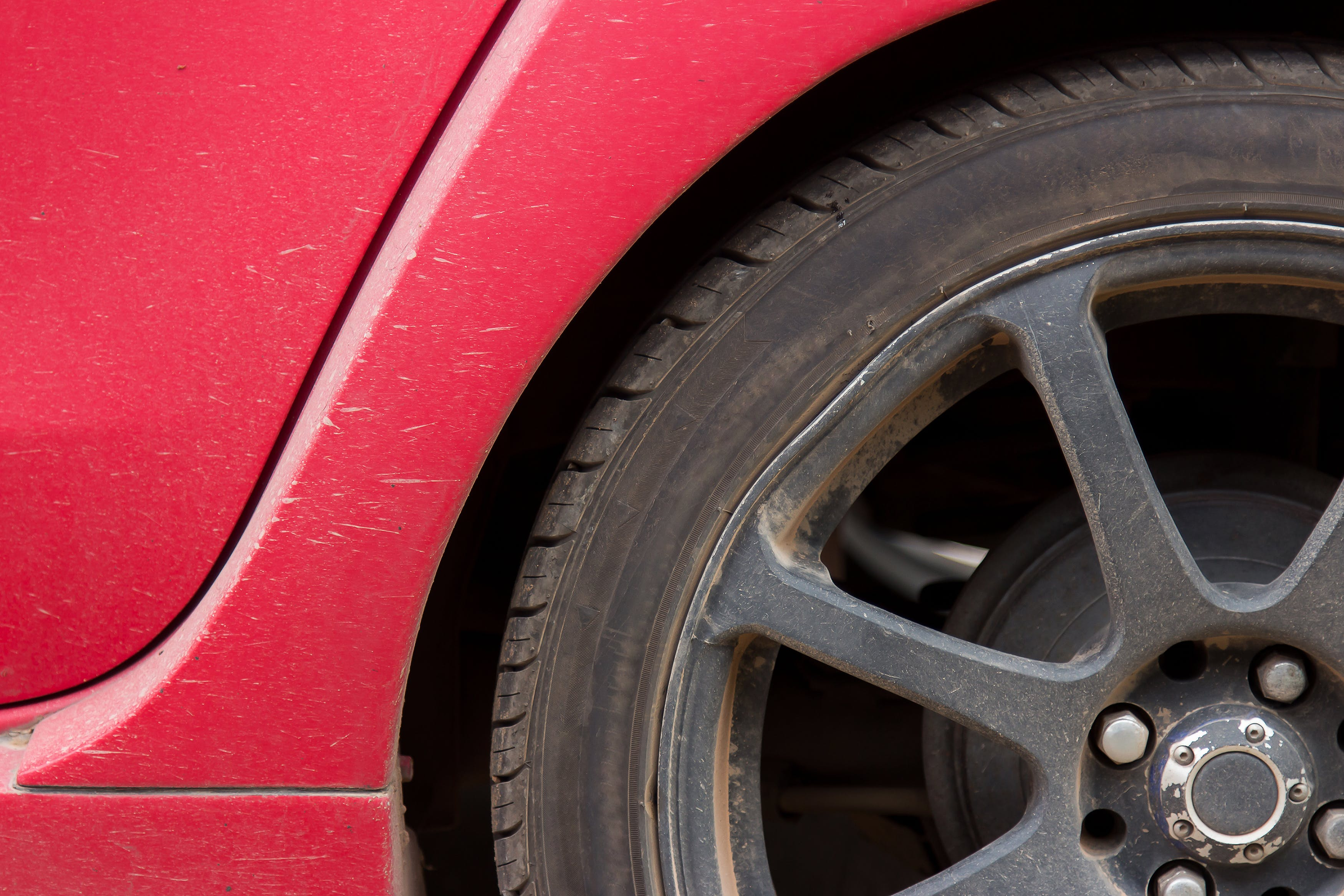 Close-up Photo of Vehicle Wheel and Tire