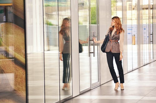 Free stock photo of attractive, building, business woman opening door