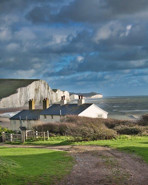 Free stock photo of clouds, coastal landscape, house, seaside