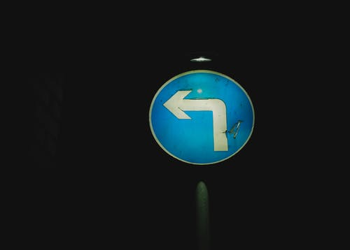 Road round sign with light at night