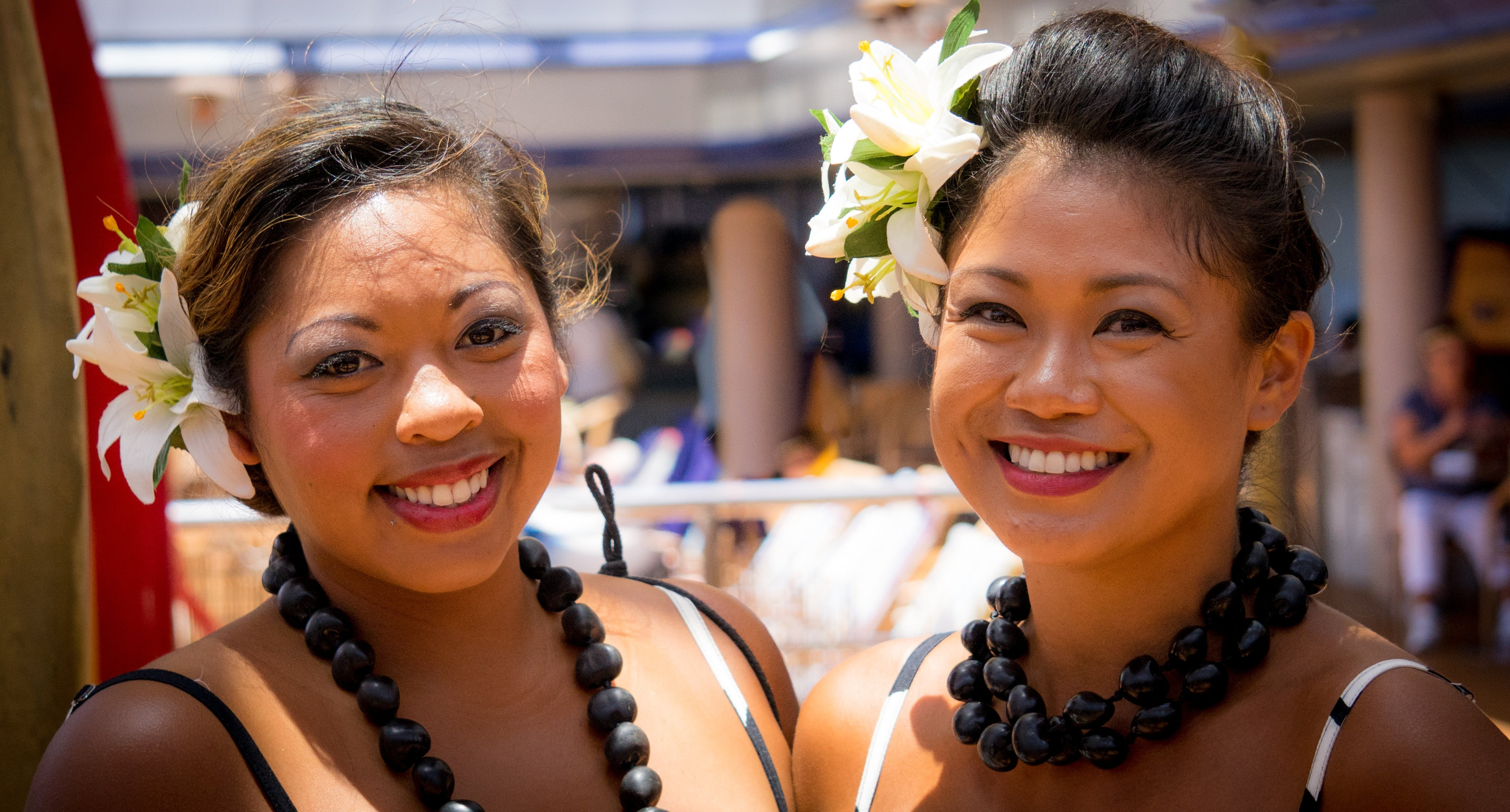 Two Smiling Woman Wearing White Floral Headdress