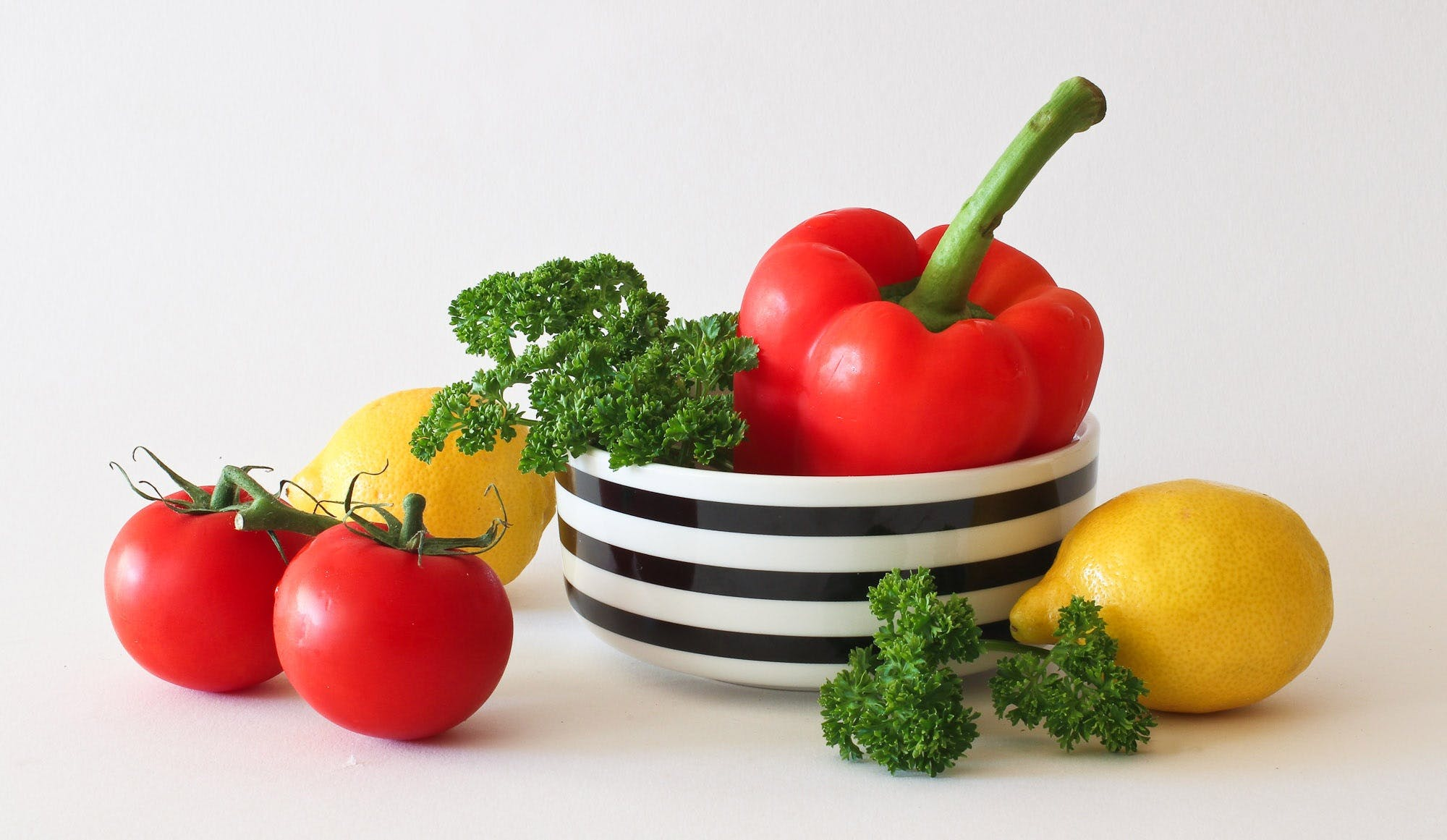 Red Tomato Green Broccoli Red Bell Pepper and Yellow Lime