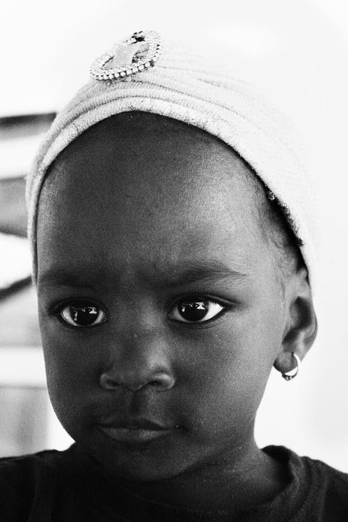 Безкоштовне стокове фото на тему «noir, африканська дитина, Африканський, великі очі»
