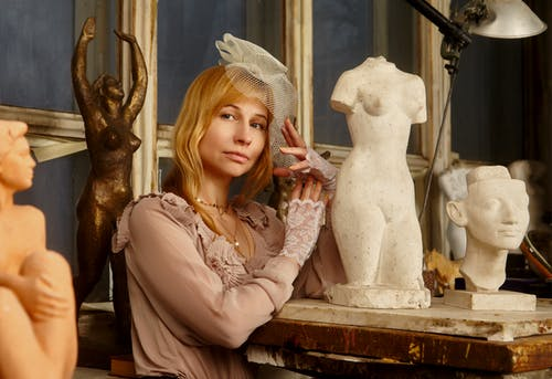 Woman Near Sculpture