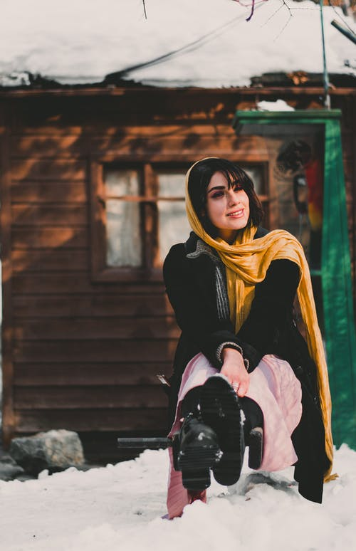 Woman in Black Long Sleeve Shirt and Yellow Scarf