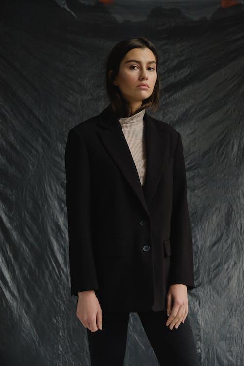 Woman Standing While Wearing Black Blazer