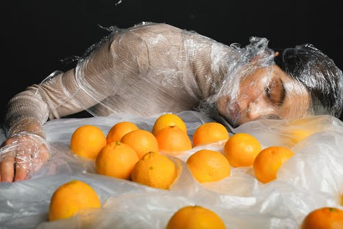 Woman Covered in Clear Plastic