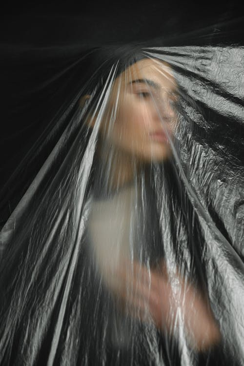 Woman Behind Clear Plastic