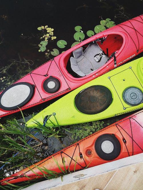Red, Green and Orange Kayaks