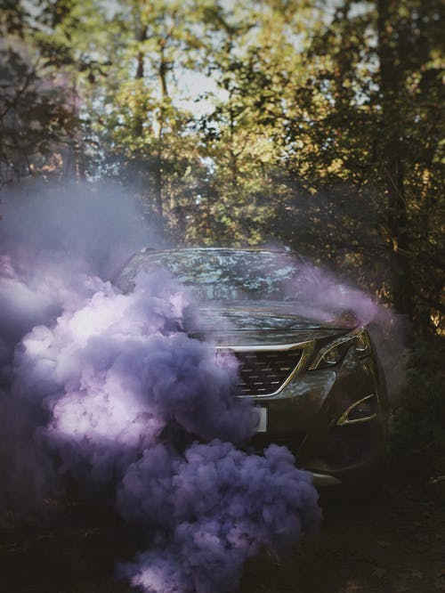 Purple Smoke Coming Out from Car