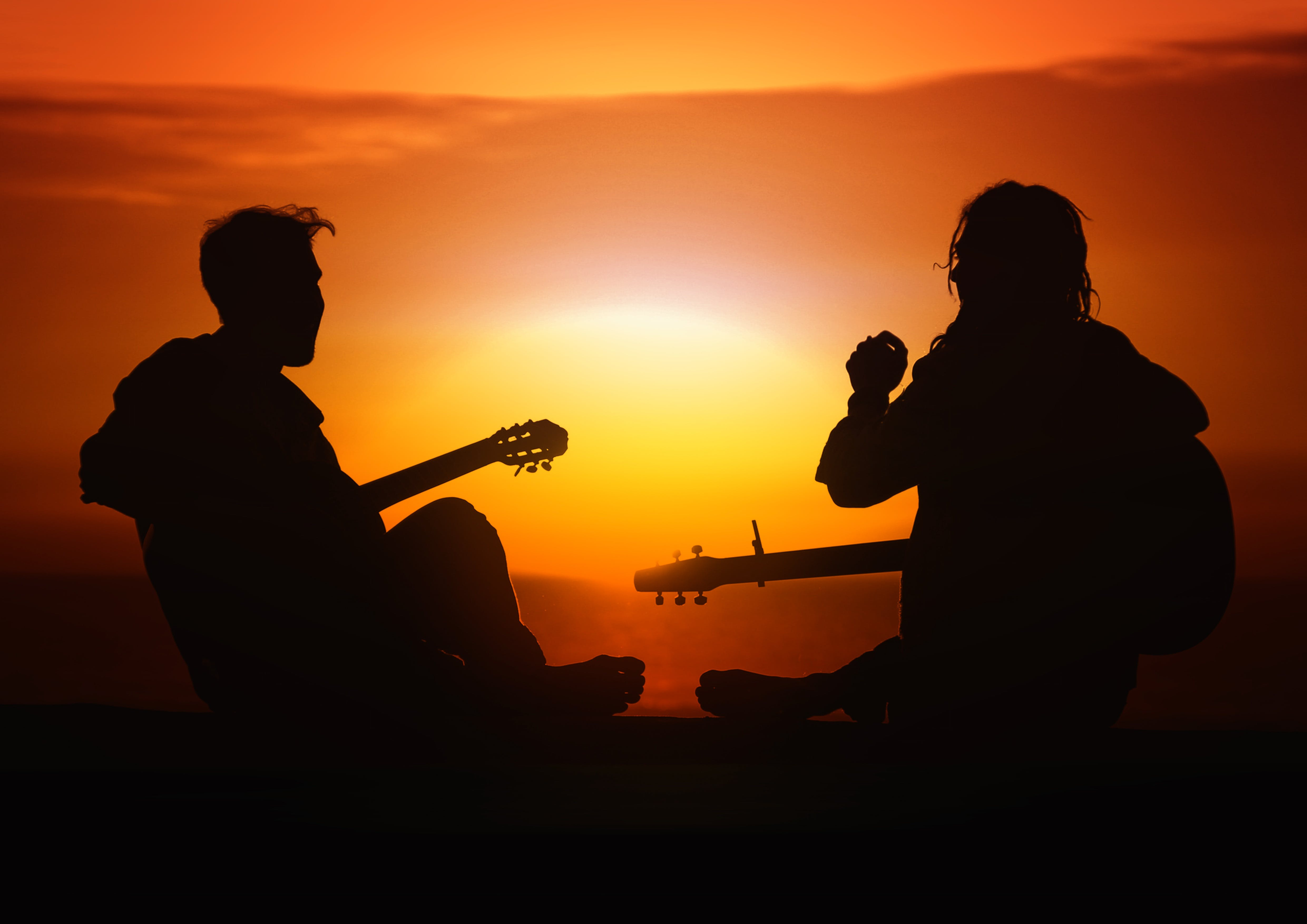 Silhouette Photography of Men Holding Guitar