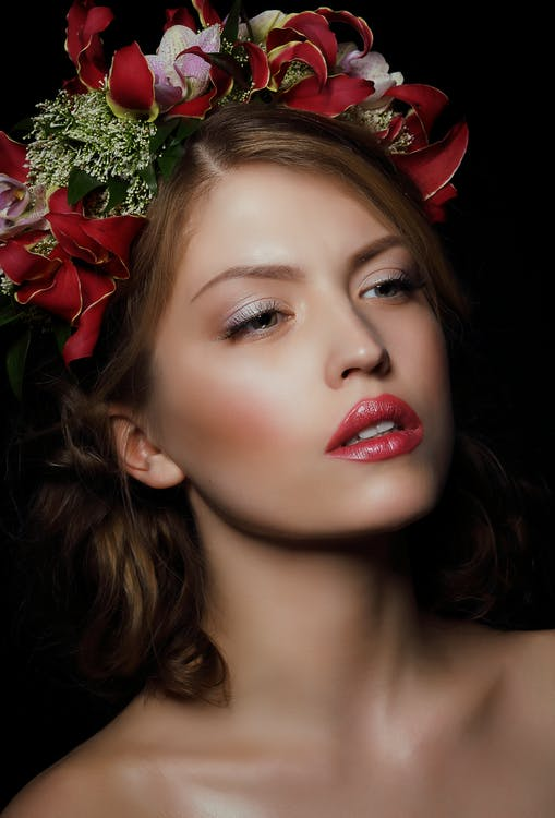 Woman Wearing Red Floral Headdress