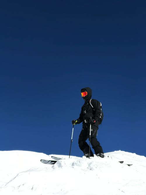 Man Skiing on Snow Covered Ground