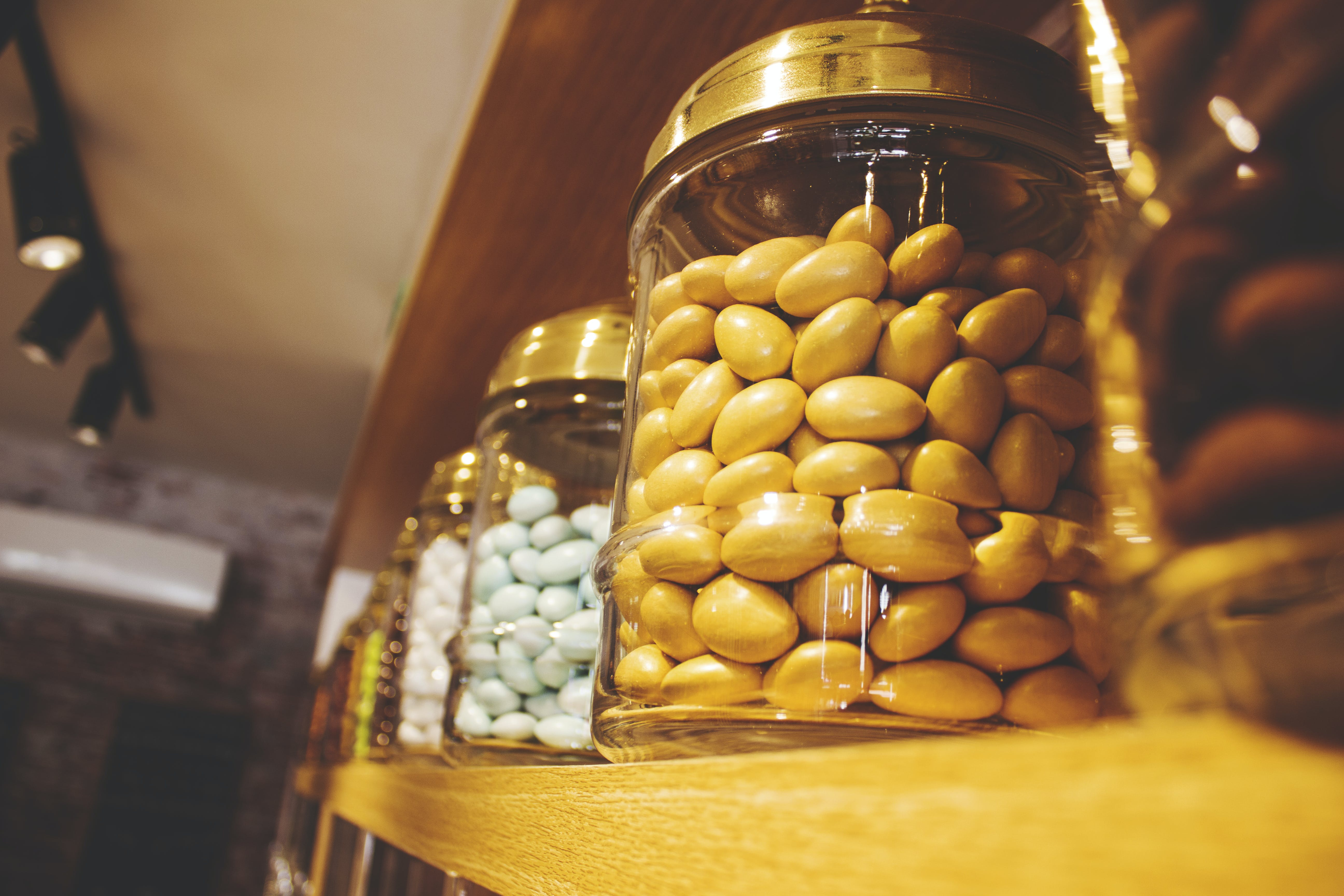 Glass Jar on Brown Wooden Shelf