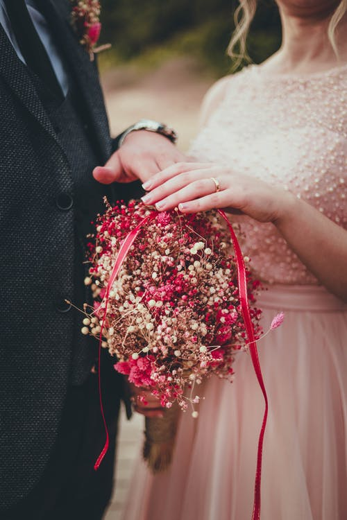 Woman Holding Red and Pink Bouquet