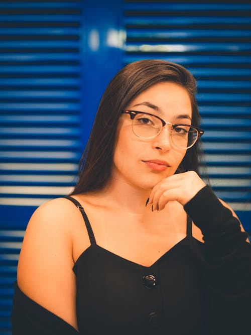 Woman in Black Spaghetti Strap Top Wearing Black Framed Eyeglasses