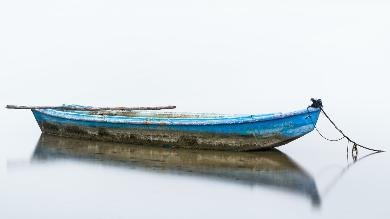 Blue and White Boat on Water