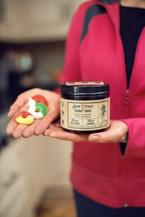 Person Holding A Jar