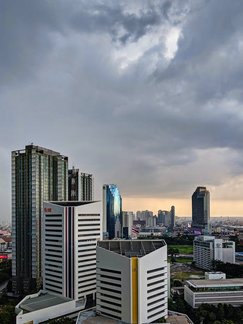 City Skyline Under Gray Cloudy Sky