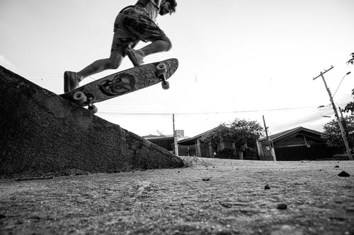 Low Angle Photo of Man Skateboarding