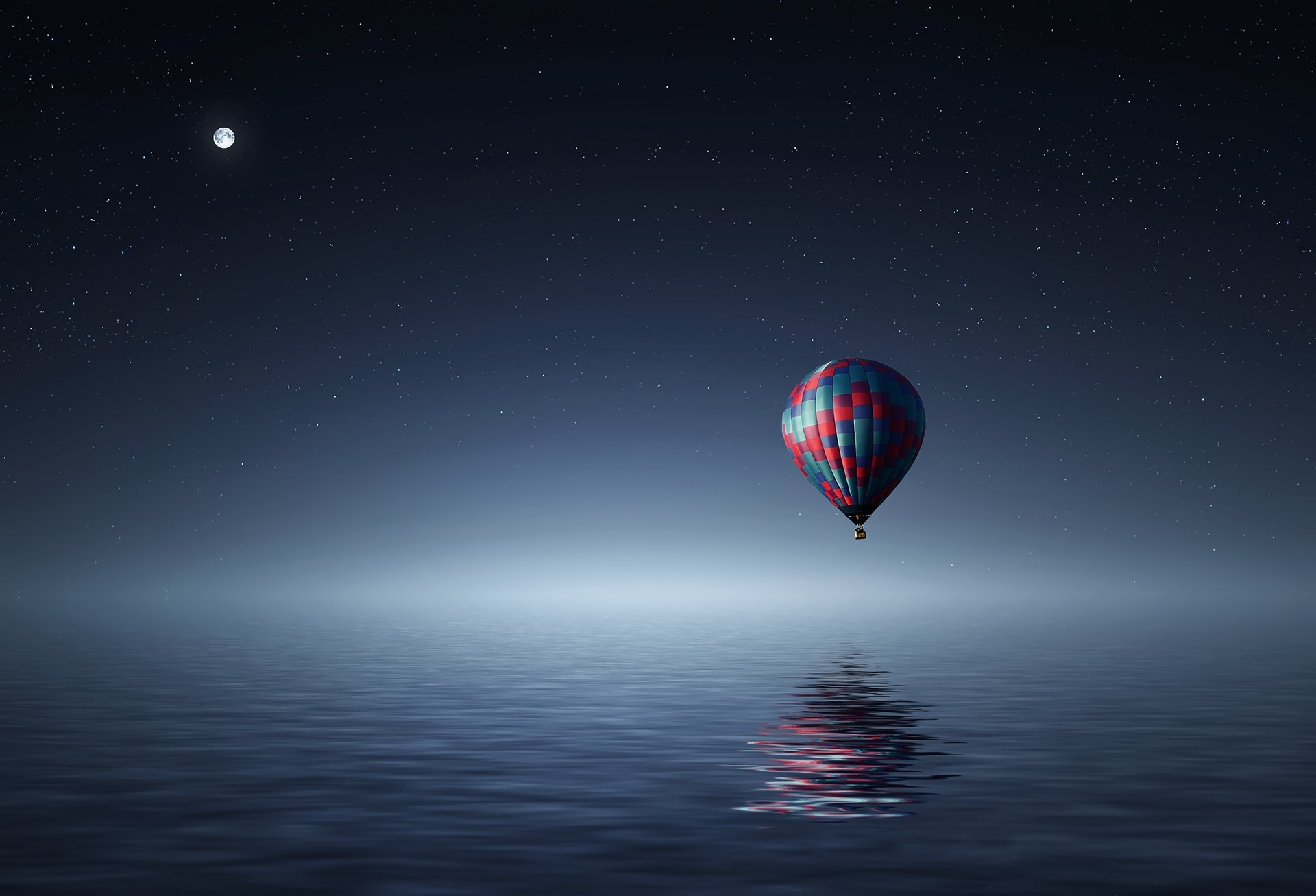 Red And Blue Hot Air Balloon Floating On Air On Body Of Water