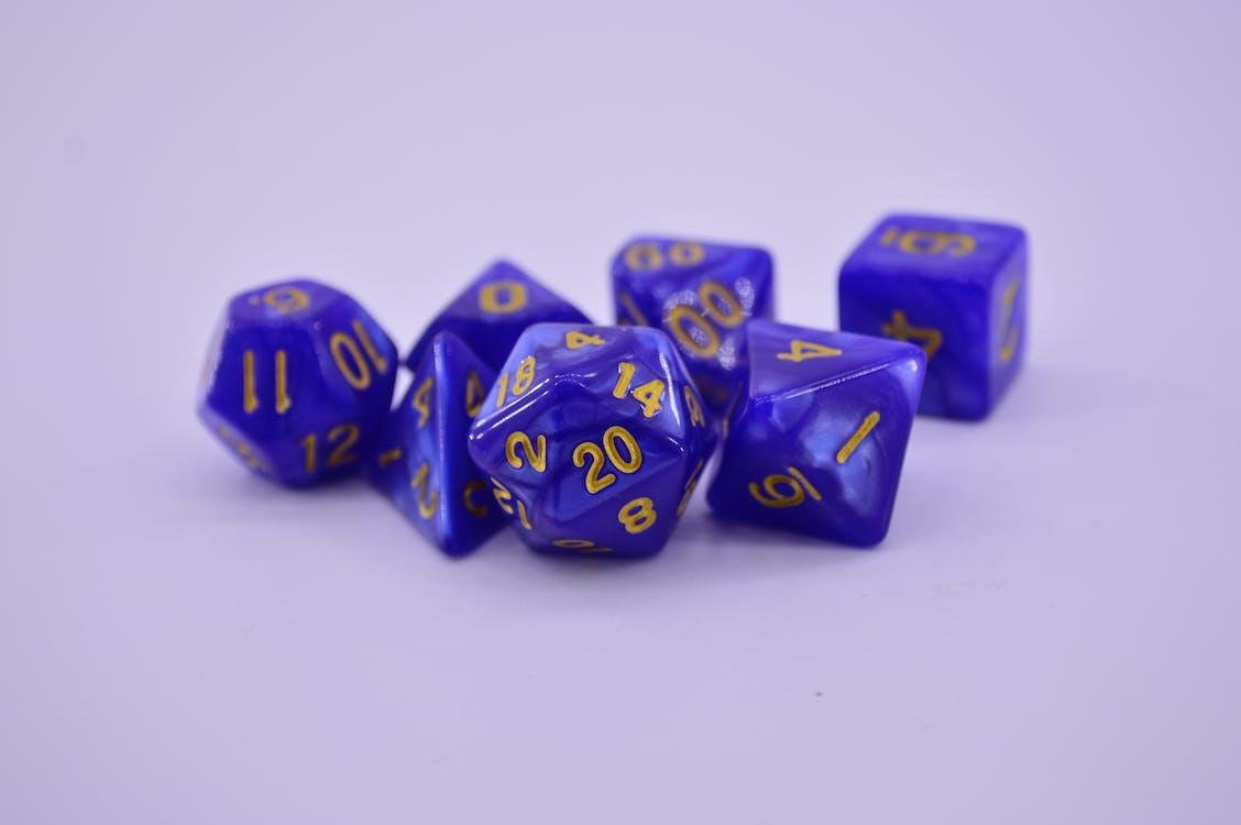 Blue and Purple Plastic Dice