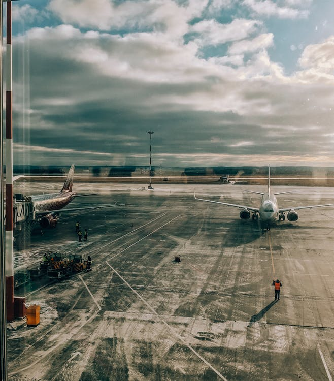 Man Standing on Airport Apron
