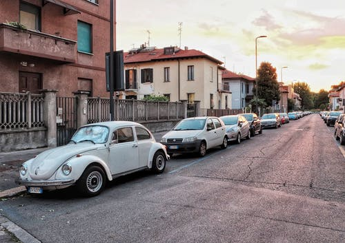 Retro car on city street at sunset