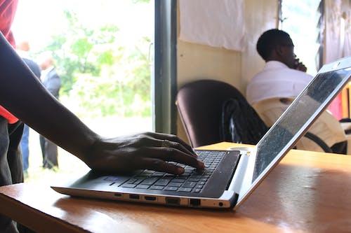 Free stock photo of africa, hand, Kenya, laptop