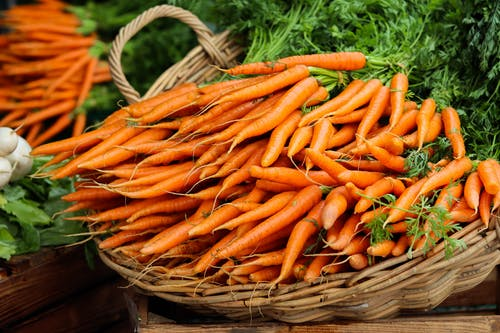 Orange Carrots on Brown Woven Basket
