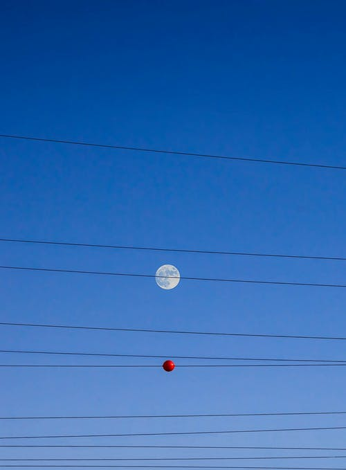 Black Power Line and Red Round Under Blue Sky