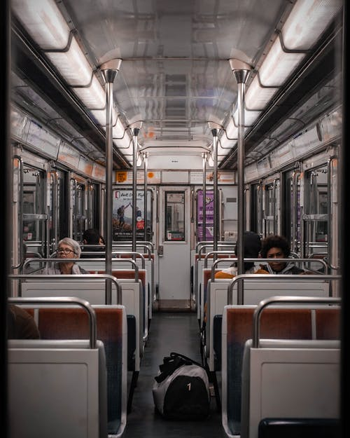 Photo Of People Sitting Inside Train