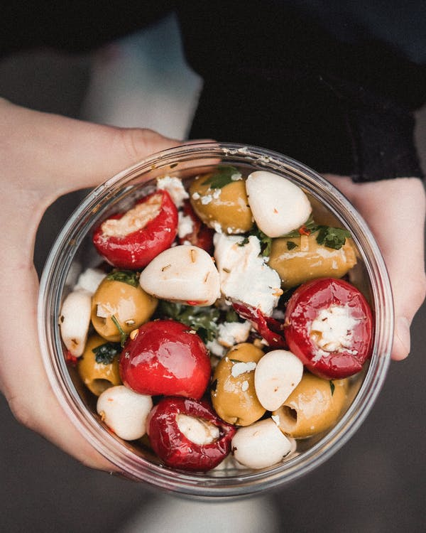 Photo Of Person Holding Bowl