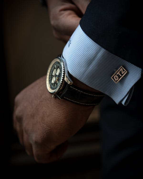 Person Wearing Black and Silver Chronograph Watch