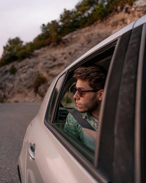Photo Of Man Sitting Inside The Car