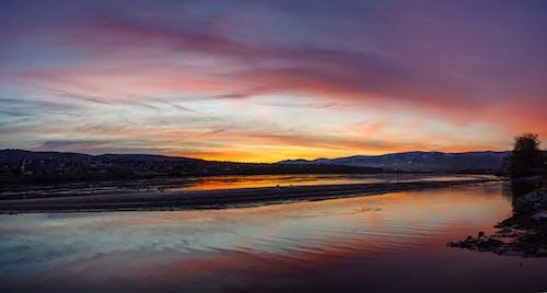 Kostnadsfri bild av flod, reflektion, soluppgång