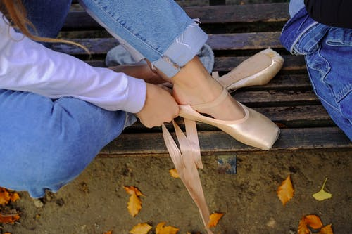 Woman in Blue Denim Jeans and Ballet Shoes
