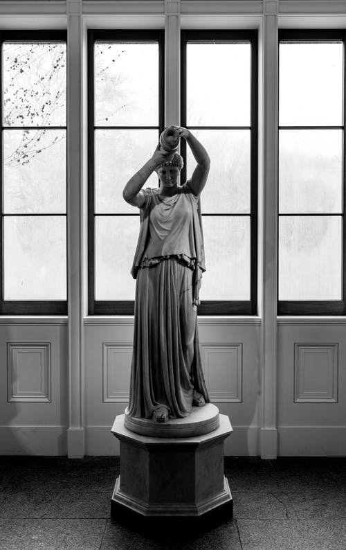 Grayscale Photo Of A Statue