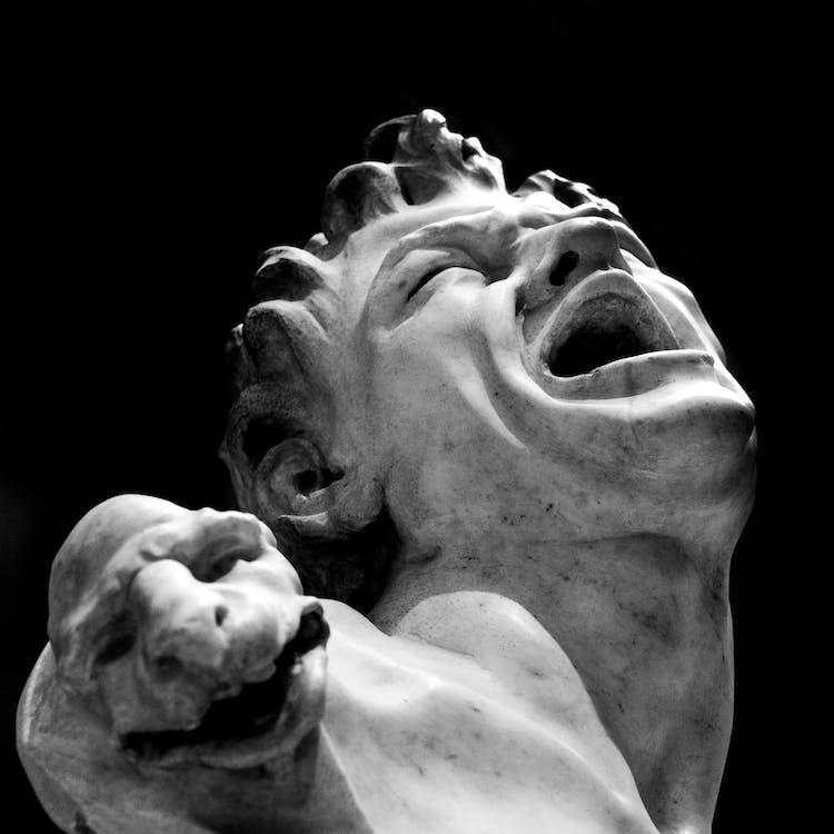 Monochrome Photo of Concrete Statue of Man