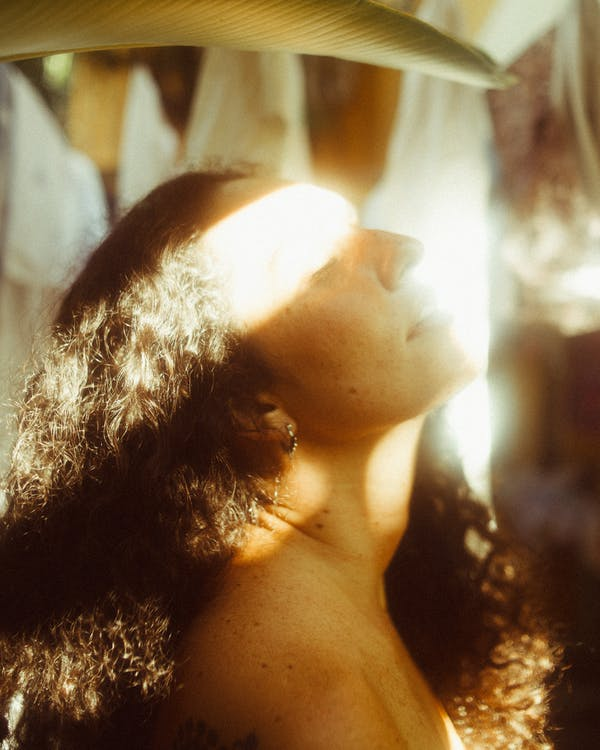 Woman With Sunlight On Her Face