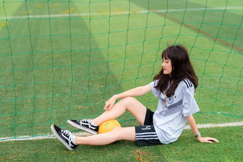 Woman Sitting by the Soccer Goal