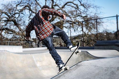 Photo of Person Skateboarding in Skate Park