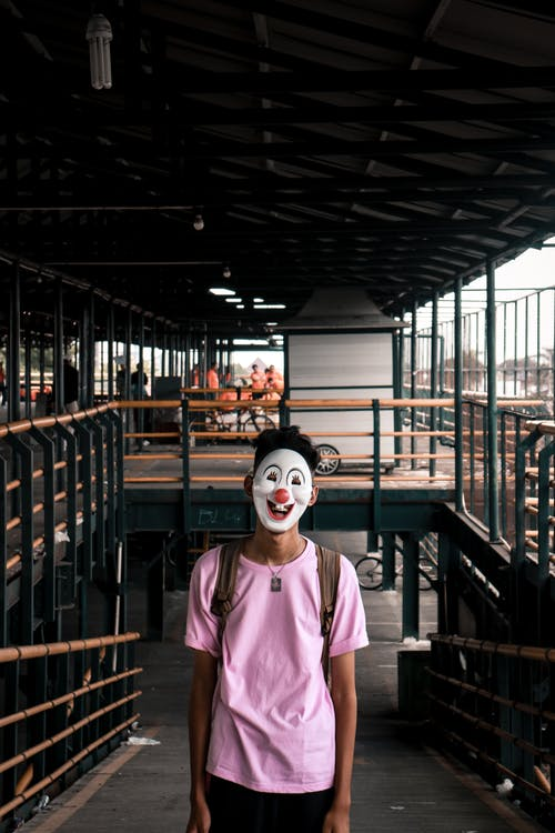 Person Wearing Pink Shirt and Face Mask