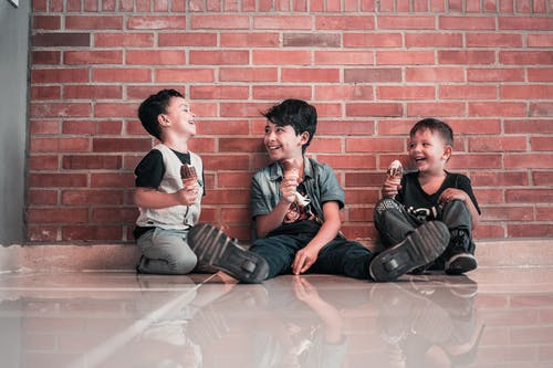 Photo of Boys Sitting on Floor