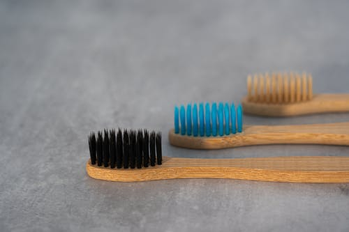 Close-Up Photo of Wooden Toothbrush