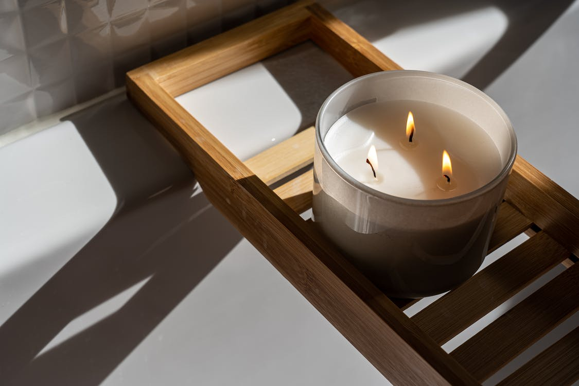 Photo Of Candle On Wooden Tray
